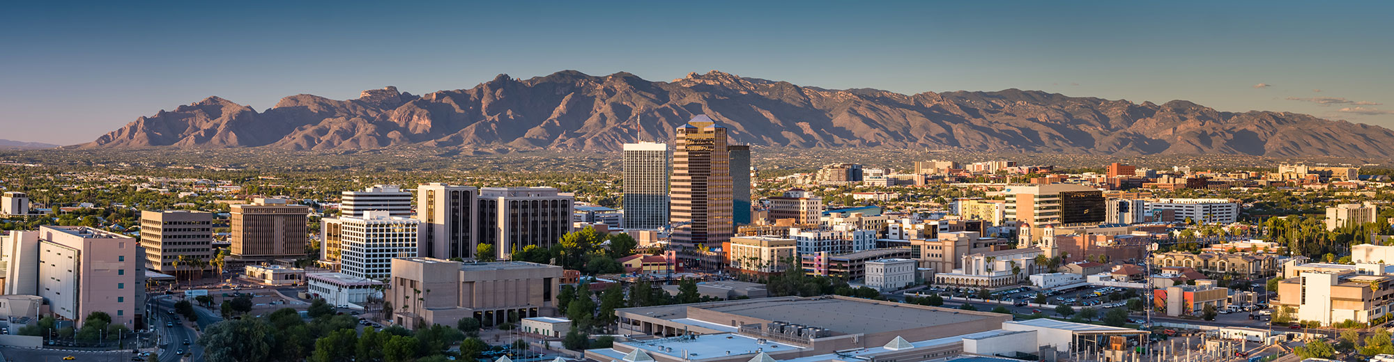 Skyline of Tucson, Arizona with downtown and mountains in background